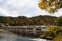 Togetsukyo bridge in autumn, Arashiyama. Togetsukyo bridge over Katsura river with cooful autumn foliage leaf at mountain in Arashiyama, Kyoto, Japan Stock Photos