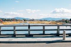 Togetsukyo most i wsi wioska przy Arashiyama w Kyoto, Japonia Zdjęcie Stock