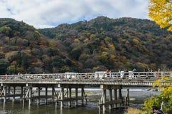 Togetsukyou Bridge during autumn season in Arashiyama, Kyoto,  J. Togetsukyo bridge over Katsura river during autumn season in Arashiyama, Kyoto, Japan Royalty Free Stock Image