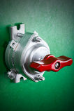 Toggle switch on green Stock Photography