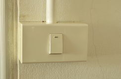 Toggle switch in plastic box on the wall Royalty Free Stock Photos