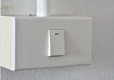 Toggle switch in plastic box on the wall Royalty Free Stock Image