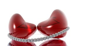 Toghether Forever. Two red hearts connected by a pearl necklace Royalty Free Stock Image