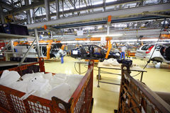 Car assembly, workers at Avtovaz factory Royalty Free Stock Photos