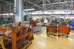 Orange containers and conveyor with bodies at Avtovaz factory Royalty Free Stock Photo
