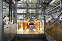 Passenger car hangs on assembly line Stock Images