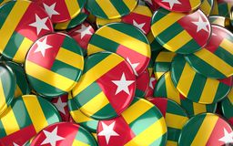 Togo Badges Background - Pile of Togo Flag Buttons. Royalty Free Stock Image