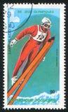 Ski Jump. TOGO - CIRCA 1980: stamp printed by Togo, shows Olympic Emblems and Ski Jump, circa 1980 Royalty Free Stock Image