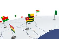 Togo flag. Country flag with chrome flagpole on the world map with neighbors countries borders. 3d illustration rendering flag stock illustration