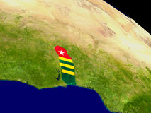 Togo with flag on Earth Stock Images