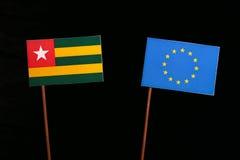 Togo flag with European Union EU flag  on black Royalty Free Stock Photography