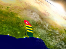 Togo with flag in rising sun Royalty Free Stock Photography
