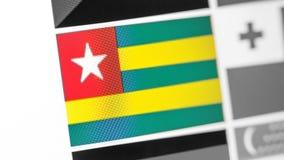 Togo-Staatsflagge des Landes Togo-Flagge auf der Anzeige, ein digitaler Wässerungseffekt stockbilder