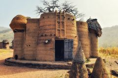 Traditional tata somba house with thatched roofs and granaries. Togo, West Africa, Nadoba, traditional tata somba house with thatched roofs and granaries royalty free stock image