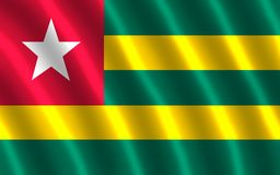The flag of Togo. Togo, a West African nation on the Gulf of Guinea, is known for its palm-lined beaches and hilltop villages. Koutammakou, inhabited by the Stock Photography