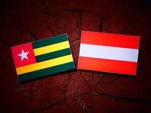 Togolese flag with Austrian flag on a tree stump  Stock Photo