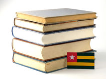 Togolese flag with pile of books isolated on white background. Togolese flag with pile of books isolated on white Royalty Free Stock Images