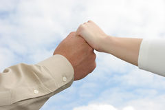 Togther. Young Couple holding hands towards sky Stock Images