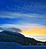 Togwotee Pass Absaroka Mountains at sunset / twilight during the winter in Wyoming. USA Stock Photo