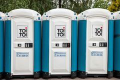 Toi Toi portable toilets with their iconic logo. Toi Toi is one of the major brand of portable sanitation systems in the world. Picture of a Row of Toi Toi royalty free stock photography