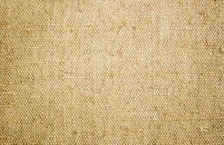 Toile approximative de jaune de toile Texture de tissu brut, toile de jute Photographie stock