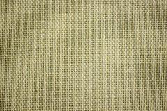 Toile approximative de jaune de toile Texture de tissu brut, toile de jute Photographie stock libre de droits