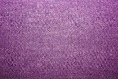 Toile approximative de pourpre de toile Texture de tissu brut, toile de jute Photographie stock