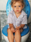 Toilet. Little girl seated on toilet Stock Images