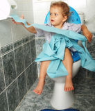 Toilet. Little girl seated on toilet Royalty Free Stock Images