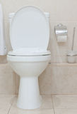 Toilet. White clean toilet bowl in modern  bathroom Stock Photos