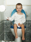 The toilet. Litlle boy and big closet Stock Photography