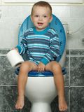 The toilet. Litlle boy and big closet Royalty Free Stock Image