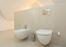Toilet. And bidet in bright modern bathroom Stock Photos