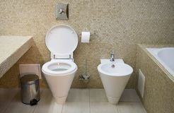 Toilet. Interior of toilet with lavatory pan and bidet Royalty Free Stock Photography