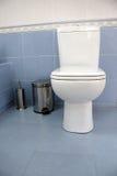 Toilet. Bathroom detail - white toilet and metalic bin Royalty Free Stock Photo