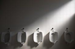 Toilet. Five pisoires in a public toilet Stock Photos