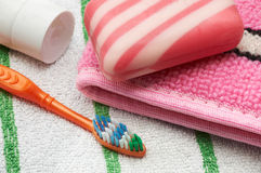 Toilet accessories. Soap a bast a tooth-brush and tooth-paste on a towel Royalty Free Stock Image