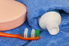 Toilet accessories. Soap a tooth-brush and tooth-paste on a towel Stock Image