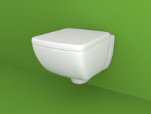 Toilet appliance. On green wall Royalty Free Stock Photo