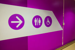 Toilet and arrow sign Stock Photo