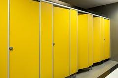 Toilet bathroom yellow door open and close Stock Photos