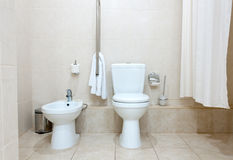 Toilet and bidet. White clean toilet bowl and bidet in modern  bathroom Stock Photography