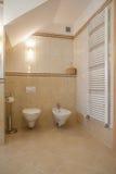 Toilet and bidet. Interior of cosy bathroom: bidet and toilet Royalty Free Stock Photo