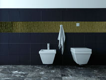 Toilet and bidet against black tiles. Picture of toilet and bidet against black tiles stock image