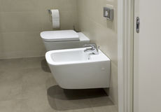 Toilet and bidet in hotel bathroom Royalty Free Stock Image