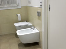 Toilet and bidet in hotel bathroom Royalty Free Stock Photo