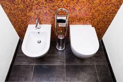 Toilet, bidet and paper Royalty Free Stock Images