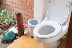 Toilet and bin at outdoor stock photography