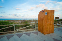 Toilet booth. Wooden toilet booth on a beach promenade Royalty Free Stock Photo
