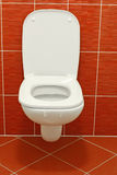 Toilet Bowl. White toilet in modern red bathroom Royalty Free Stock Image